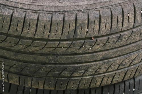 Láminas  Closeup of Old, damaged and worn black tire tread