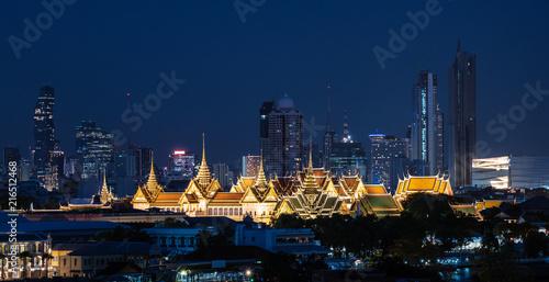 Grand palace and Wat Phra Kaew surround by modern buildings, in Bangkok city Tha Fototapeta