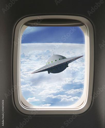 Foto op Canvas UFO UFO-Sichtung aus Flugzeugfenster