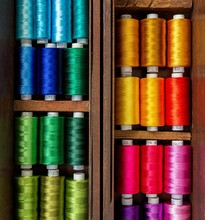 Close Up Picture Of Spool Of Colorful Threads In The Old Wooden Box