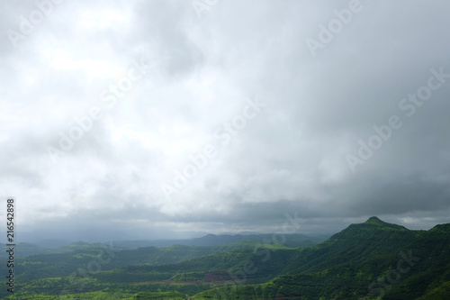 Fotobehang Wit Lush green monsoon nature landscape mountains, hills, Purandar, Pune, Maharashtra, India