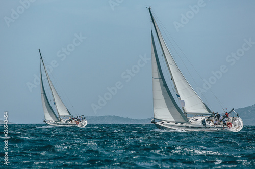 Two yachts sail boats racing in a blue sea