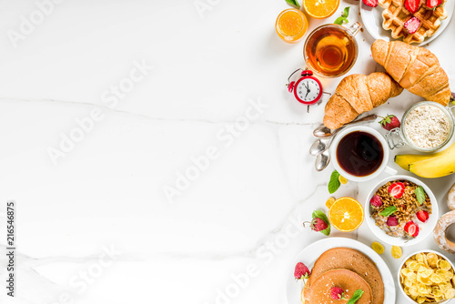 Cuadros en Lienzo Healthy breakfast eating concept, various morning food - pancakes, waffles, croi
