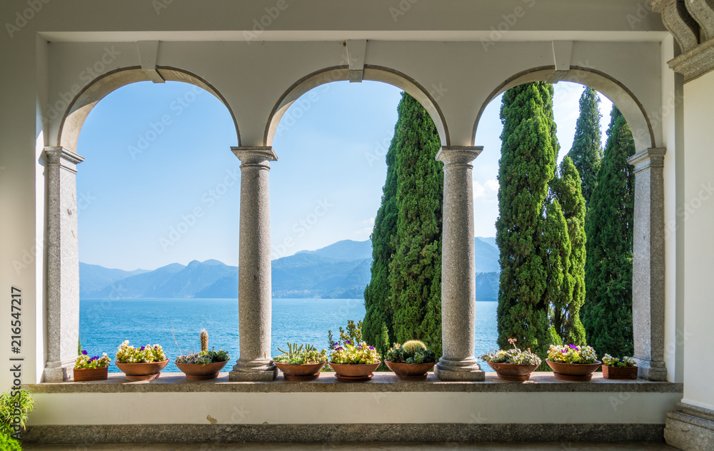 Fototapeta The beautiful Villa Monastero in Varenna on a sunny summer day. Lake Como, Lombardy, Italy.