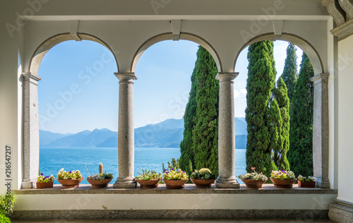 Photo Stands Lake The beautiful Villa Monastero in Varenna on a sunny summer day. Lake Como, Lombardy, Italy.