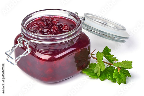 Photo  Gooseberry jam with fresh berries, isolated on white background.