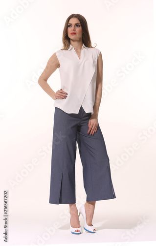 a8306544c80 young caucasian business woman executive posing in summer casual print  blouse and culottes trousers high heels stiletto shoes full body length  isolated on .