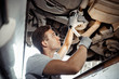 Safety first: an automechanic is conducting a detailed examinati