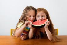 Little Girls Sharing A Slice O...