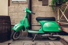 Retro Style Green Scooter On Lviv Street. Exterior, Restaurant Design. Modep Left Outdoors