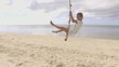 SLOW MOTION, Young woman playing on beach, swing rope on palm tree People travel vacations fun concept. Shot in HD, Philippines, Asia