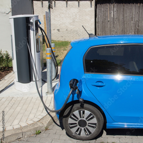 an electric vehicle charging at EV charging station