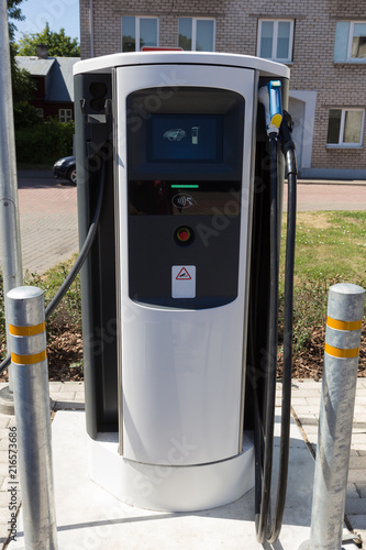 Charging station for electric vehicles, electro car charging station on gas station Poster