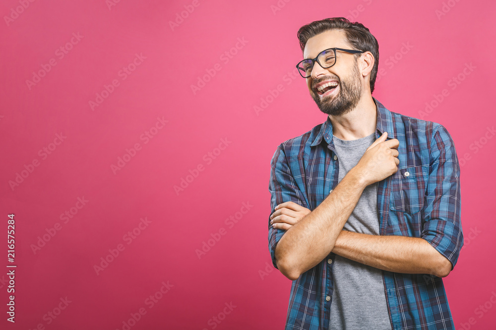 Fototapety, obrazy: Portrait of a handsome casual man who laughs, standing and laughing over pink background
