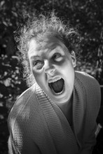 Dramatic Young Furious Woman Screaming With Rage, Outdoor Portrait