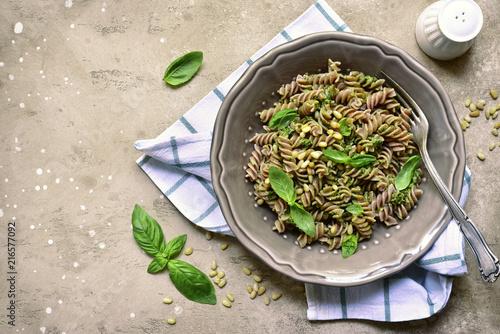 Obraz na płótnie Delicious whole wheat pasta fusilli with basil pesto and pine nuts