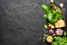 Ingredients For Making Traditional Italian Sauce Pesto : Basil Leaves, Parmesan Cheese, Olive Oil, Garlic, Pine Nuts And Sea Salt. Top View With Copy Space.