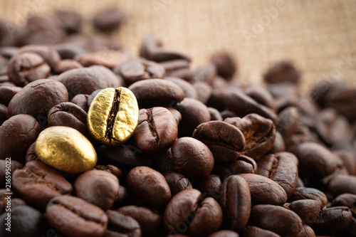 Fototapeta  Gold coffee beans on a pile of coffee beans