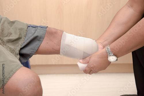 Photo below knee stump bandaging, amputee BKA with prothesis preparing