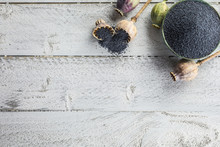 Poppy Seed With Their Heads On Wooden Boards