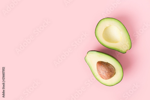 Fotografie, Tablou Half and full raw avocado minimalism pastel