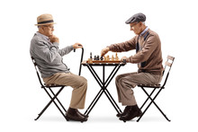 Seniors Playing A Game Of Chess