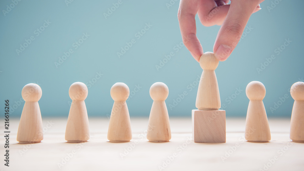 Fototapeta Successful team leader, Businessman hand choose people standing out from the crowd.