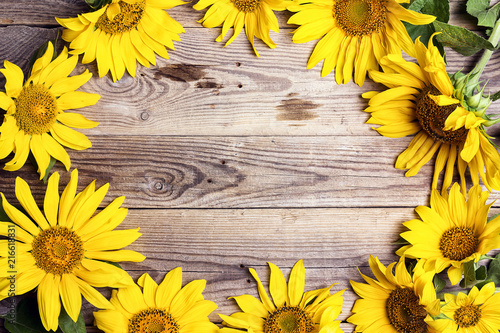 In de dag Zonnebloem Frame of yellow sunflowers on a old wooden backgrounds. Space for text.