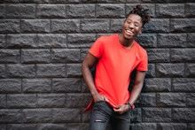 African Smiling Male Model Standing In Empty Red T-shirt Against Brick Wall