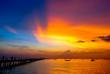 Leinwandbild Motiv Nice dramatic sky at sea with silhouette of port