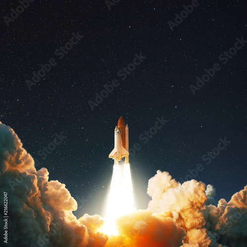 The space shuttle rockets launch into space on the starry sky. spacecraft flies into space with clouds of smoke. Concept