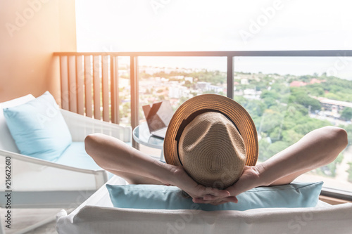 Relaxation healthy living lifestyle summer holiday vacation of freelancer woman take it easy resting in comfort chair in resort hotel balcony having peace of mind and self health quality balance #216622610