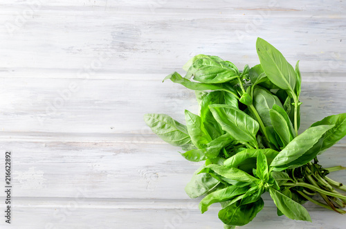 Fotobehang Kruiderij branch Green basil on wood background