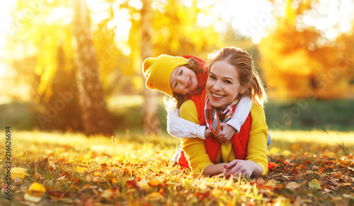 Fototapeta happy family mother and child daughter on   autumn walk obraz