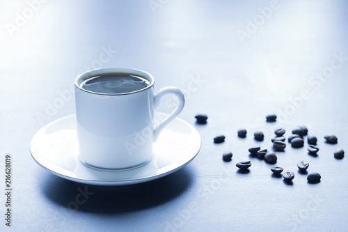 A cup of fragrant hot coffee on the morning table