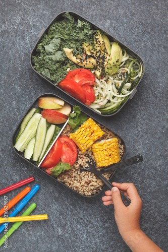 Foto op Aluminium Assortiment Healthy meal prep containers with quinoa, avocado, corn, zucchini noodles and kale. Child is eating at school from lunch box.