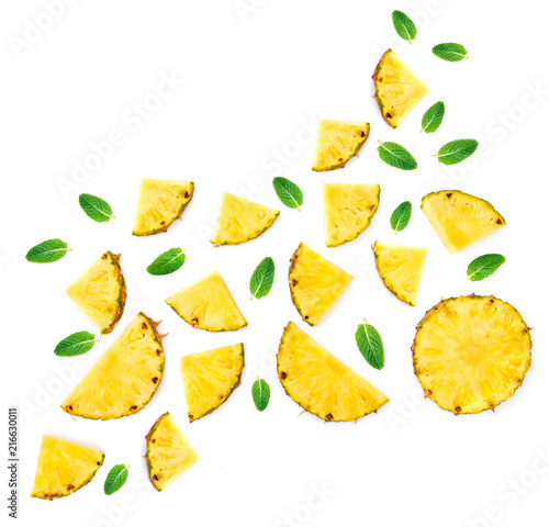 Sliced Pineapple Isolated.  Pineapple pieces  with green mint  leaves on white background. Flat lay. Summer concept .