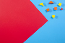 Colorful Wooden Blocks On Blue And Red Background