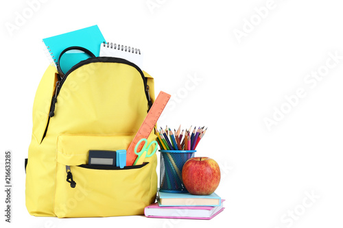 Fotografía  Yellow backpack with school supplies on white background