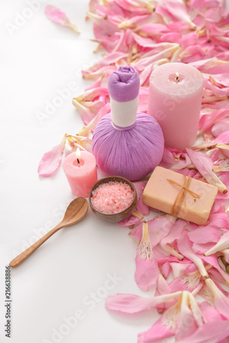 Poster Spa Pile of many pink petals background with and herbal,candle ,soap ,salt in bowl,