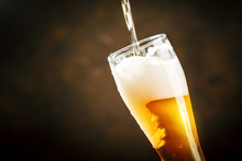 A Glass Of Beer On A Dark Background.