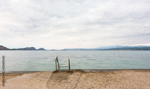 Spoed Foto op Canvas Mediterraans Europa Overcast seascape from a jetty with swimming pool ladder plungeing in to the sea in Pylos, Greece.