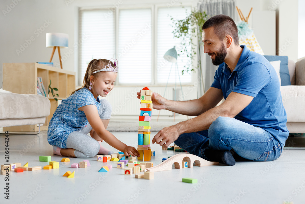 Fototapety, obrazy: Father with daughter playing together at home