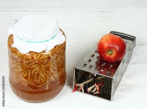 Handmade apple vinegar from organic red   apples / Grated apples with peels, wat Canvas Print