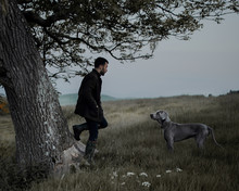 Man With A Dog In The Countryside