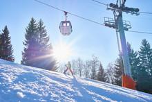 Child Skier Standing Under Cable Car, Lauenen, Valais, Switzerland