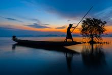Silhouette Fisherman On Boat O...