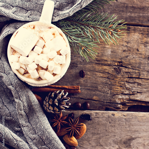 gift, fir branch, nuts, cones, Cocoa, coffee, cozy knitted blanket. Winter, New Year, Christmas still life