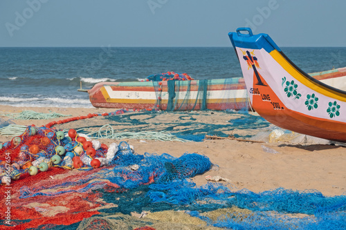 Part of the local fishing fleet  and nets on the beach at Mamallapuram in Tamil Nadu. The main catches taken in the Bay of Bengal inshore fishery are pomfrets and prawns