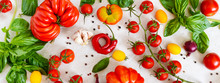 Cherry Tomato Branch, Garlic, Fresh Basil, Pepper On A Light Background. Ingredients For Making Sauces. Italian Cuisine. Banner.